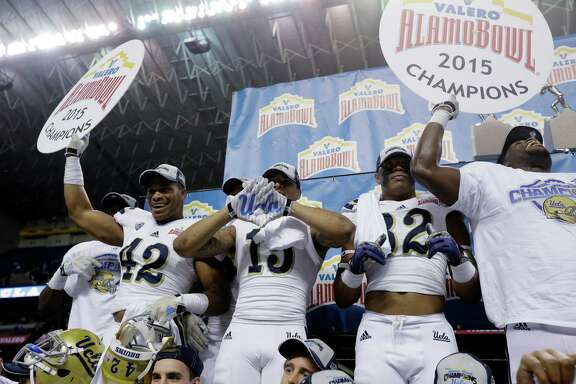 UCLA players celebrate after winning the Alamo Bowl NCAA college football game against Kansas State on Jan. 2, 2015, in San Antonio. UCLA won 40-35.