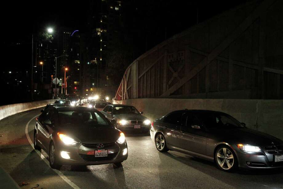 Vehicles move slowly onto the Bay Bridge via the First Street on-ramp after a multivehicle crash on the eastern span Nov. 8 in San Francisco. Photo: Leah Millis / The Chronicle / ONLINE_YES
