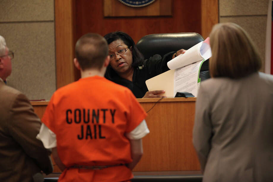 An appeals court has ruled that certifications that juveniles can be tried as adults need to be fact based and not a pro-forma process. Here, Seth Andrew Yates, 16, center, stands before District Judge Carmen Kelsey as he pleads guilty on first-degree murder charges in March 2012. As part of the plea agreement, he was sentenced to 20 years in prison. Yates killed retired U.S. Army sergeant George Michael Iser, 59, in April 2011. Photo: Jerry Lara /San Antonio Express-News / © 2012 San Antonio Express-News