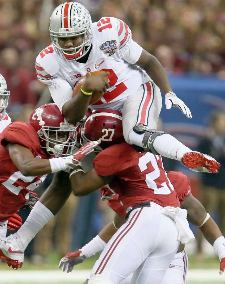 Quarterback Cardale Jones (12) has helped Ohio State clear postseason hurdles provided by Wisconsin (Big Ten title game) and Alabama (Sugar Bowl). Photo: Phil Masturzo / McClatchy-Tribune News Service / Akron Beacon Journal