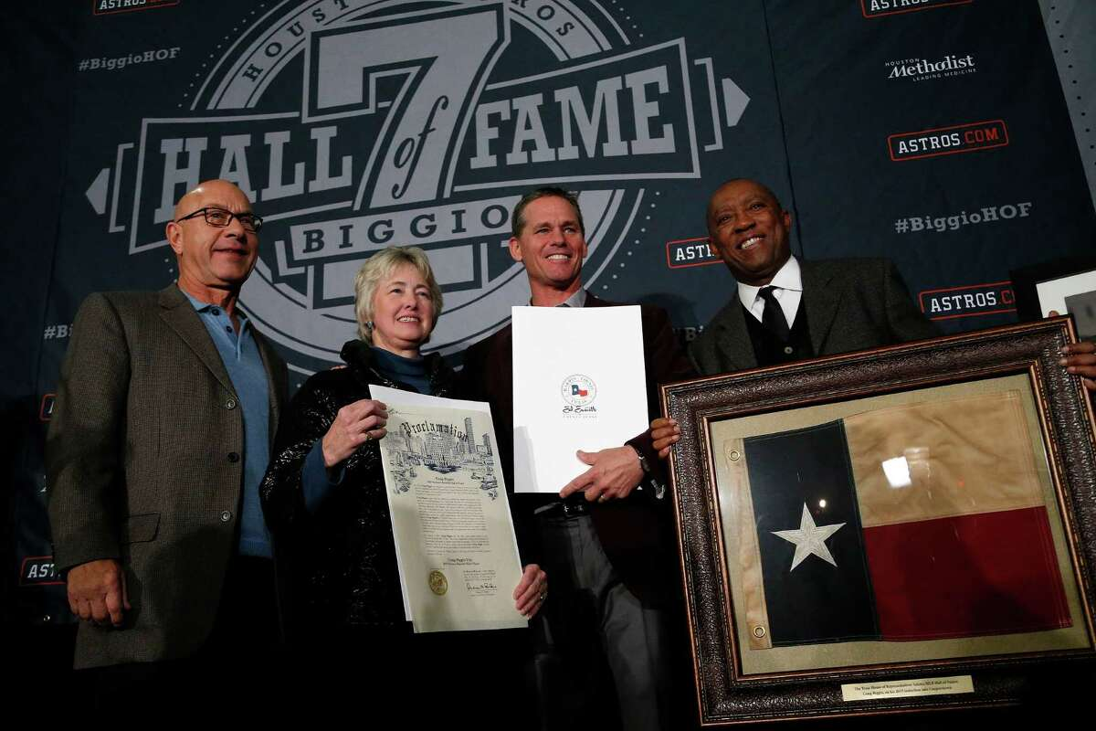 Senator John Whitmire, Mayor Annise Parker, Craig Biggio, and Sylvester Turner with all of Biggio's declarations and a Texas flag that flew over the Texas State Capitol during the Hall of Fame celebration for Craig Biggio at Union Station, Friday, Jan. 9, 2015, in Houston.