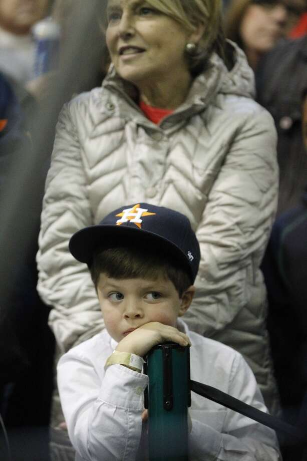 A little Astros fan waits for more than an hour inside before the start of the Hall of Fame celebration for Craig Biggio at Union Station, Friday, Jan. 9, 2015, in Houston.  ( Karen Warren / Houston Chronicle  ) Photo: Karen Warren, Houston Chronicle