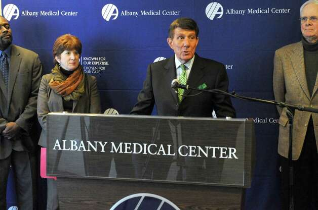 Albany Medical Center CEO James Barba and Mayor Kathy Sheehan, left,  announce that the medical center had purchased the former Matthew Bender building on Boradway for $3 million Friday, Jan. 9, 2015 in Albany, N.Y. Albany Med will move 350 workers into the building over the next three months.  (Michael P. Farrell/Times Union)(Michael P. Farrell/Times Union) Photo: Michael P. Farrell / 00030141A