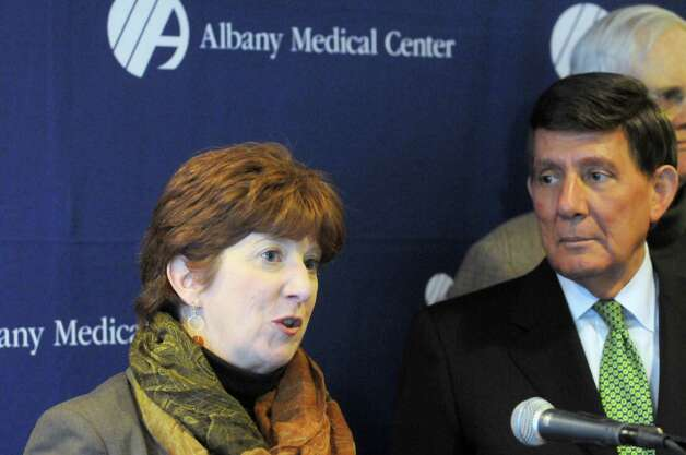 Mayor Kathy Sheehan, left, and Albany Medical Center CEO James Barba announced the medical center's purchase of former Matthew Bender building on Broadway for $3 million Friday, Jan. 9, 2015 in Albany, N.Y. Albany Med will move 350 workers into the building over the next three months.  (Michael P. Farrell/Times Union)(Michael P. Farrell/Times Union) Photo: Michael P. Farrell / 00030141A
