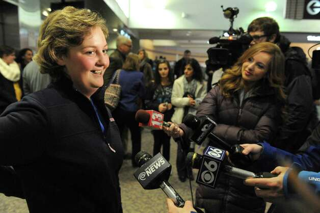 Seventeen-year-old Hannah Priamo of Amsterdam is interviewed by local media after returning from her Make-A-Wish trip to the People's Choice Awards in Los Angeles, and marking the chapter's 1,500th local wish, at Albany International Airport on Friday Jan. 9, 2015 in Colonie, N.Y. (Michael P. Farrell/Times Union) Photo: Michael P. Farrell / 00030131A