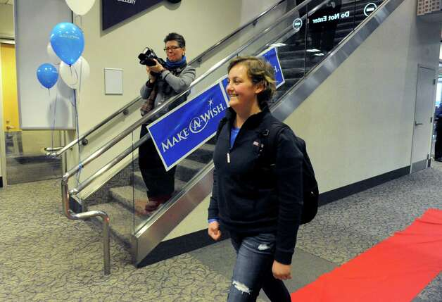Seventeen-year-old Hannah Priamo of Amsterdam returns from her Make-A-Wish trip to the People's Choice Awards in Los Angeles, and marking the chapter's 1,500th local wish, at Albany International Airport on Friday Jan. 9, 2015 in Colonie, N.Y. (Michael P. Farrell/Times Union) Photo: Michael P. Farrell / 00030131A