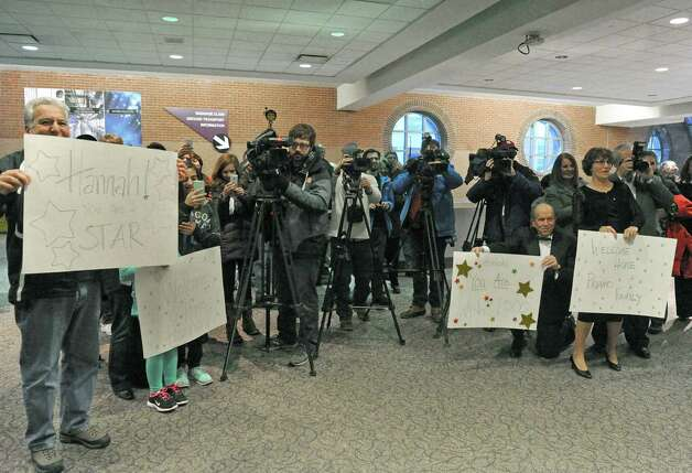 Seventeen-year-old Hannah Priamo of Amsterdam is welcomed back by family and friends from her Make-A-Wish trip to the People's Choice Awards in Los Angeles, and marking the chapter's 1,500th local wish, at Albany International Airport on Friday Jan. 9, 2015 in Colonie, N.Y. (Michael P. Farrell/Times Union) Photo: Michael P. Farrell / 00030131A