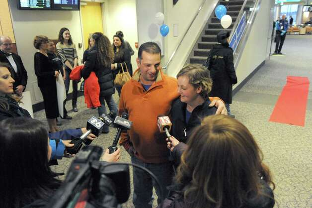 Seventeen-year-old Hannah Priamo of Amsterdam and her father Paul Priamo are interviewd by local media after returning from her Make-A-Wish trip to the People's Choice Awards in Los Angeles, and marking the chapter's 1,500th local wish, at Albany International Airport on Friday Jan. 9, 2015 in Colonie, N.Y. (Michael P. Farrell/Times Union) Photo: Michael P. Farrell / 00030131A