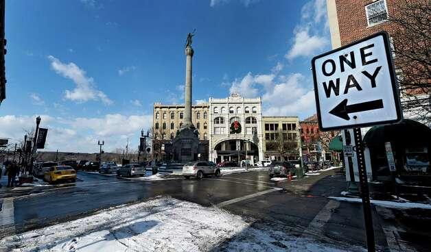 A one-way sign borders Monument Square at the intersection of Broadway and Second St. Friday afternoon, Jan. 9, 2015, in Troy, N.Y. (Skip Dickstein/Times Union) Photo: SKIP DICKSTEIN / 00030142A