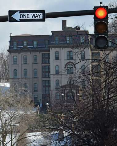 A one-way sign hangs above the intersection of 4th and Fulton Streets Friday afternoon Jan. 9, 2015 in Troy, N.Y.     (Skip Dickstein/Times Union) Photo: SKIP DICKSTEIN / 00030142A