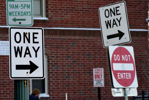 One-way signs near the intersection of Broadway and Frear Alley at Monument Square Friday afternoon, Jan. 9, 2015, in Troy, N.Y.  (Skip Dickstein/Times Union) Photo: SKIP DICKSTEIN / 00030142A