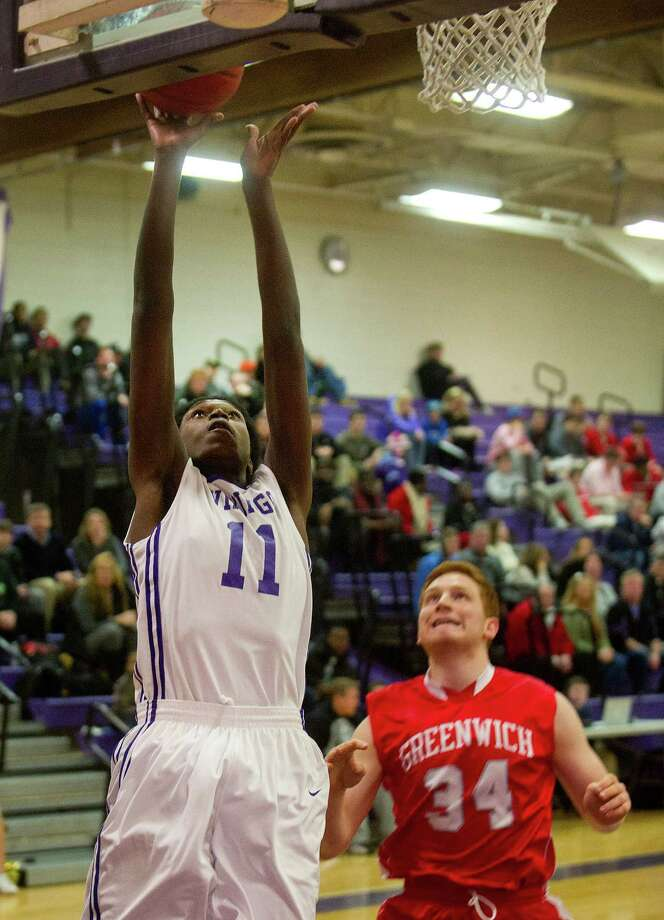 Westhill's Lenold Auguste takes a shot during Friday's basketball game against Greenwich at Westhill High School on January 9, 2015. Photo: Lindsay Perry / Stamford Advocate