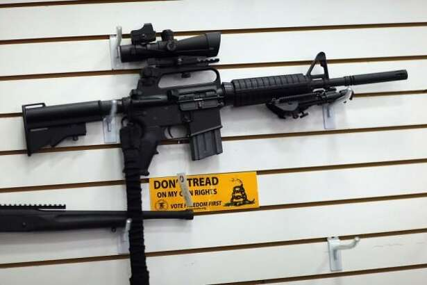 AR-15, semi-automatic, magazine-fed rifle: Gun rights groups plan a big protest next Thursday, on the steps of the state capitol in Olympia, against Initiative 594. The voter-passed measure requires criminal background checks for those purchasing firearms at gun shows or over the Internet.