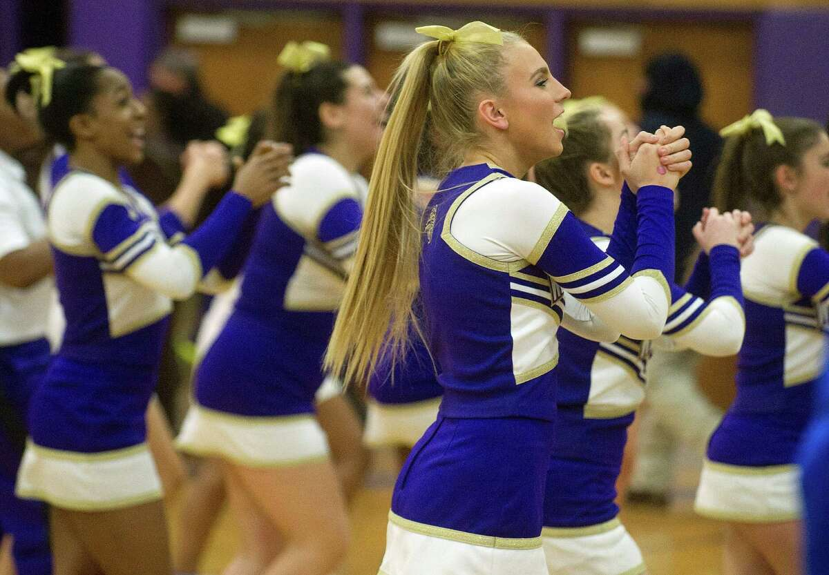 Westhill cheerleaders perform at halftime during Friday's basketball game against Greenwich at Westhill High School on January 9, 2015.