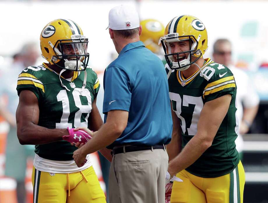 Miami Dolphins head coach Joe Philbin greets Green Bay Packers wide receivers Randall Cobb (left) and Jordy Nelson before a game on Oct. 12, 2014. According to the Packers, Nelson and Cobb became the first duo in NFL history with 90 catches, 1,200 yards and 12 or more touchdowns in the same season. Photo: Wilfredo Lee /Associated Press / AP