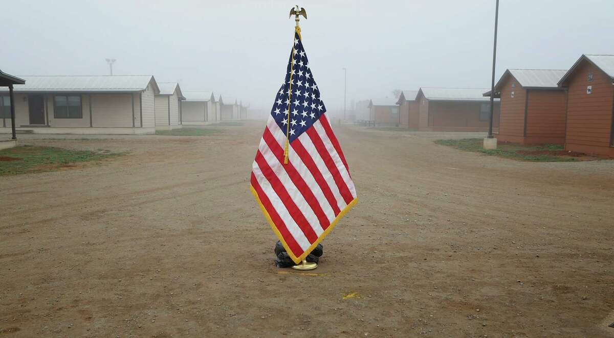 An American flag is set in the middle of the pathway, where Secretary of Homeland Security Jeh Johnson toured the new South Texas Family Residential Center, just outside Dilley, Texas. Detained immigrants that are currently being held in Artesia will begin arriving at the Dilley facility within the next two weeks. This pictured center, built as a
