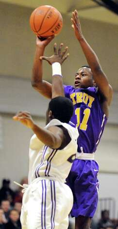 Troy's Dyaire Holt, right, shoots for the hoop as CBA's Taurian Taylor defends during their basketball game on Friday, Jan. 9, 2015, at Christian Brothers Academy in Colonie, N.Y. (Cindy Schultz / Times Union) Photo: Cindy Schultz / 00030125A