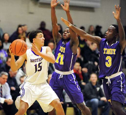 CBA's Mike Wynn, left, looks to pass as Troy's Dyaire Holt, center, and Darius Holmes-Hines defend during their basketball game on Friday, Jan. 9, 2015, at Christian Brothers Academy in Colonie, N.Y. (Cindy Schultz / Times Union) Photo: Cindy Schultz / 00030125A
