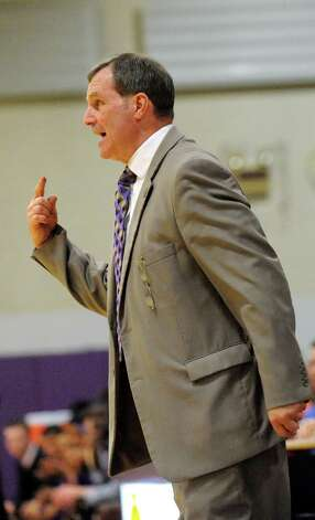 CBA's coach Dave Doemel instructs his team from the sidelines during their basketball game against Troy on Friday, Jan. 9, 2015, at Christian Brothers Academy in Colonie, N.Y. (Cindy Schultz / Times Union) Photo: Cindy Schultz / 00030125A