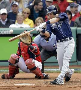 Tampa Bay Rays second baseman Ben Zobrist connects for a home run off Boston Red Sox starting pitcher Jon Lester, left, in front of Red Sox catcher Jarrod Saltalamacchia during the fourth inning of Game 1 of baseball's American League division series, Friday, Oct. 4, 2013, in Boston. (AP Photo/Stephan Savoia)
