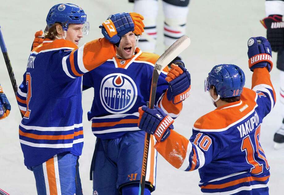 From left, Edmonton's Jeff Petry, Derek Roy and Nail Yakupov celebrate Petry's second-period goal against Chicago. Photo: JASON FRANSON / Associated Press / The Canadian Press