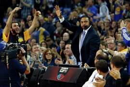 Warriors' fans welcome ESPN analyst Mark Jackson back during the game. A stream of players, fans and friends stopped by to shake the hand of the former Warriors' coach.