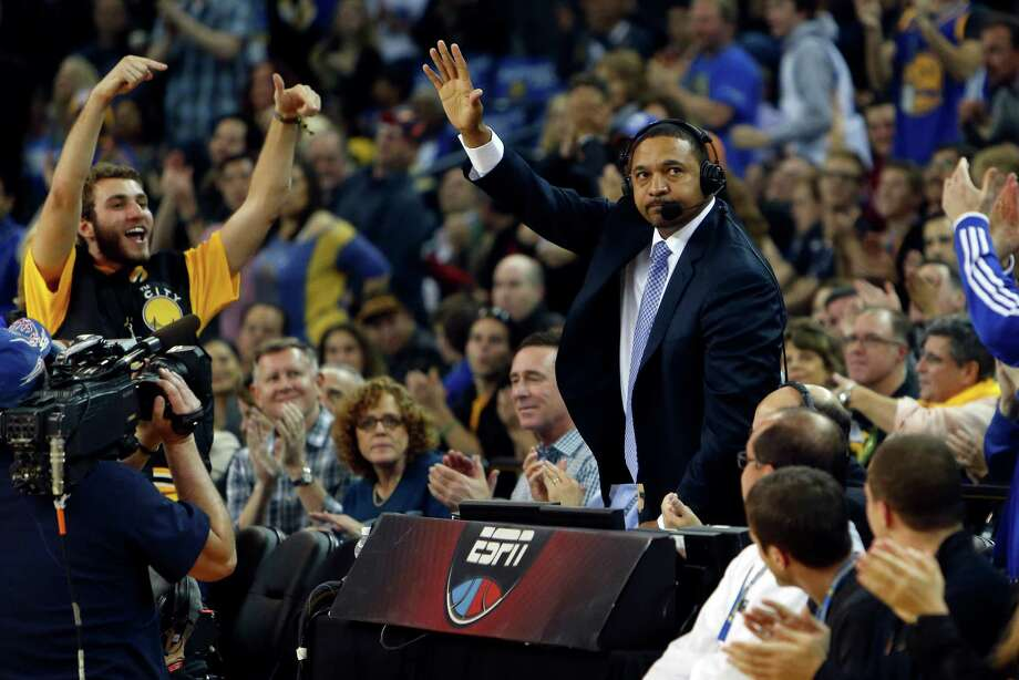 Warriors' fans welcome ESPN analyst Mark Jackson back during the game. A stream of players, fans and friends stopped by to shake the hand of the former Warriors' coach. Photo: Scott Strazzante / The Chronicle / ONLINE_YES