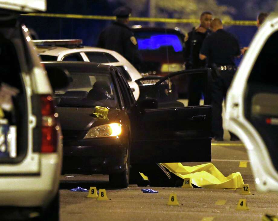 A car sits at the scene of a quadruple homicide on Laguna Street near Page Street in San Francisco on Friday. Photo: Scott Strazzante / The Chronicle / ONLINE_YES