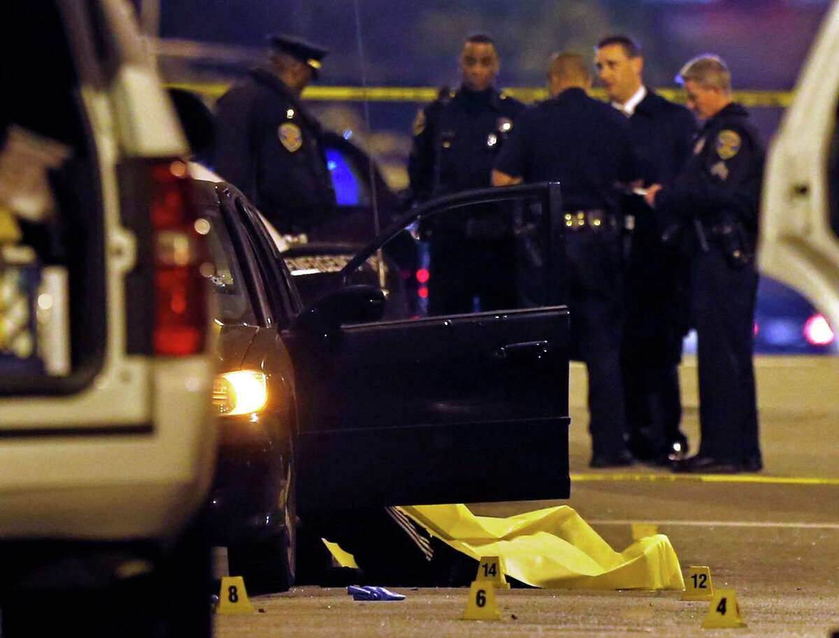 Police work at the scene of a quadruple homicide on Laguna Street near Page Street in San Francisco on Friday.