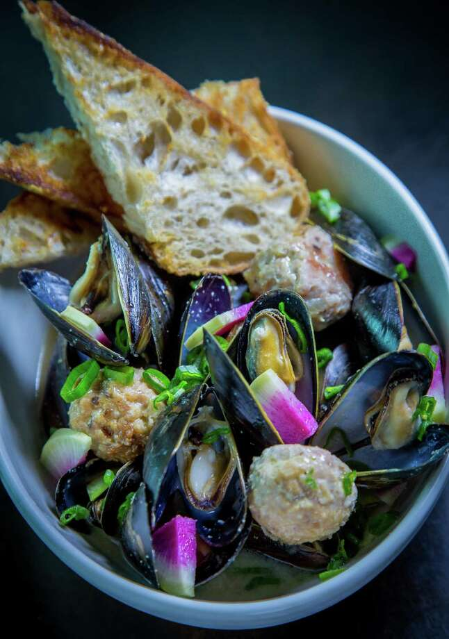 Baked mussels, left, are among the small, but substantial, plates. Photo: John Storey / Special To The Chronicle / ONLINE_YES