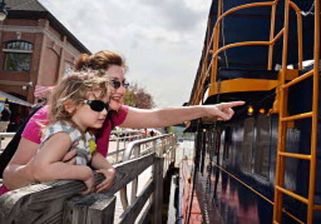 Mary Wilcox of Waterford and granddaughter Stella Wards Fowler, 3, of Schenectady help celebrate the opening of the Erie Canal's 2014 season at  RiverSpark Canal Festival on May 10 in Waterford. The canal went on to have a stronger year for traffic than during 2013. (John Carl D'Annibale / Times Union)