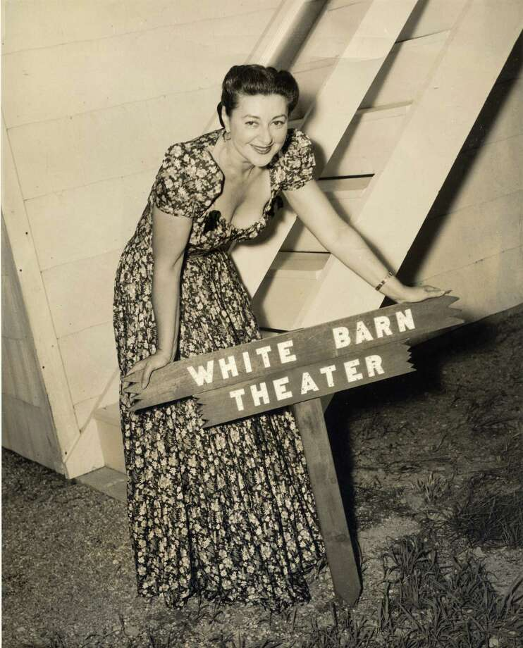 Lucille Lortel, shown here at her White Barn Theatre in Westport, opened the 148-seat theater in 1947 to provide a venue for new play development, as well as to offer established playwrights, actors, composers and others a place to experiment. A developer is proposing to demolish the old theater and develop housing at the site. Photo: Contributed Photo / Stamford Advocate Contributed