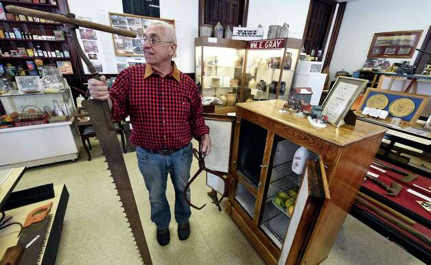 Tom Ragosta, president, holds up ice harvesting implements which are part of a display at the Watervliet Historical Society Friday afternoon, Jan. 9, 2015 in Watervliet, N.Y.  The display was set up in advance of a speech on the subject of ice harvesting by Tom Ragosta, president of the Watervliet Historical Society. The event is scheduled for Monday Jan. 12, 2015, at 7 p.m. at the Watervliet Senior Citizens Center. (Skip Dickstein/Times Union) Photo: SKIP DICKSTEIN / 00030115A