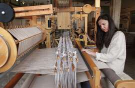 Textiles designer Adele Stafford, at work in her studio, will be part of the FOG Design+Art Fair, where she will be weaving on her 7-by-7-by-7-foot Ahrens Violette mechanical dobby loom.