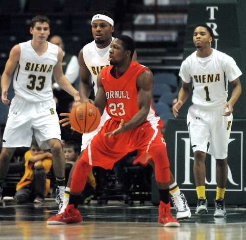Cornell's Galal Cancer a former Christian Brothers Academy standout started against Siena during their men's college basketball game at the Times Union Center on Tuesday Dec. 23, 2014 in Albany, N.Y. (Michael P. Farrell/Times Union) Photo: Michael P. Farrell / 00029973A