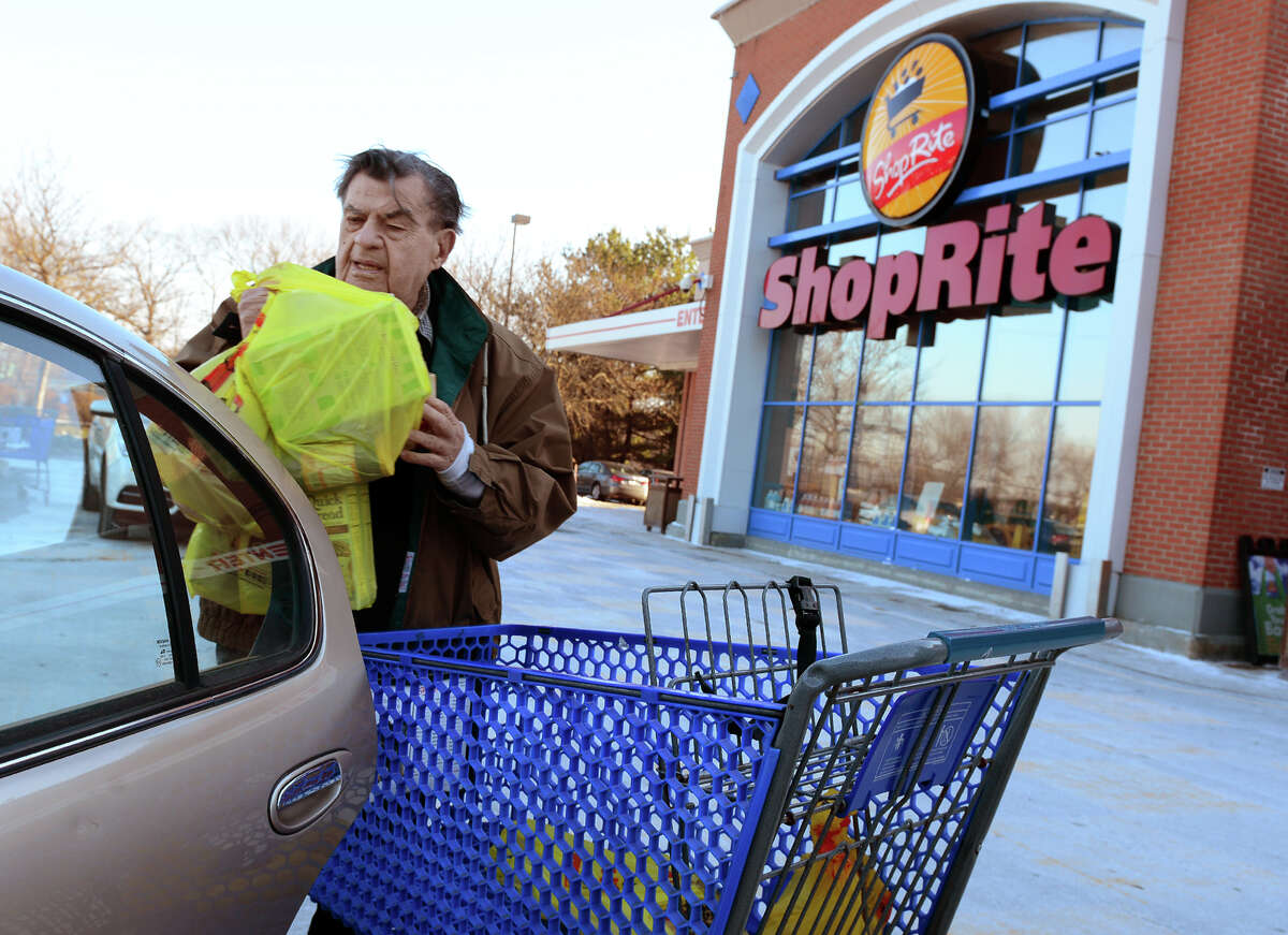 Dr. Stanley Brovender, of Stratford, loads up his vehicle with groceries at the Shop Rite in Shelton, Conn., on Saturday Jan. 10, 2015. The state is considering a ban on plastic bags like the ones in the cart. If outlawed buyers would be forced to either bring their own bags or pay for store paper bags.