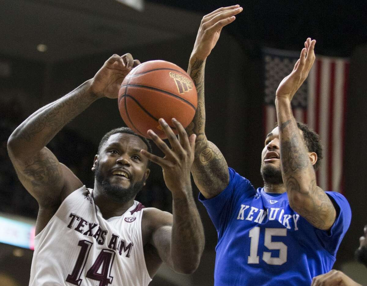 Texas A&M forward Kourtney Roberson (14) grabs a rebound away from Kentucky forward Willie Cauley-Stein (15) during the first half of a college basketball game at Reed Arena on Saturday, Jan. 10, 2015, in College Station. ( Brett Coomer / Houston Chronicle )