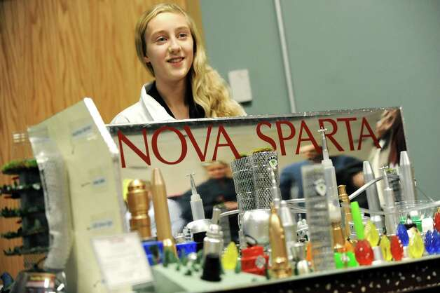 Anna LeClair, 13, of O'Rourke Middle School presents her team's futuristic city, Nova Sparta, during the National Engineers Week Future City Competition on Saturday, Jan. 10, 2015, at Proctors Theatre in Schenectady, N.Y. (Cindy Schultz / Times Union) Photo: Cindy Schultz / 00030088A