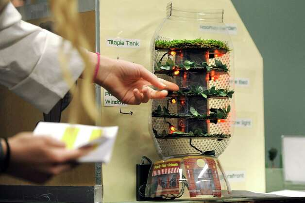 Anna LeClair, 13, of O'Rourke Middle School shows the tilapia and kale farm portion of her team's futuristic city, Nova Sparta, during the National Engineers Week Future City Competition on Saturday, Jan. 10, 2015, at Proctors Theatre in Schenectady, N.Y. (Cindy Schultz / Times Union) Photo: Cindy Schultz / 00030088A