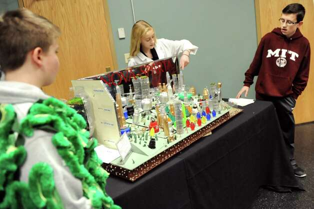 Presenters from O'Rourke Middle School do a skit for judges to describe their team's futuristic city, Nova Sparta, during the National Engineers Week Future City Competition on Saturday, Jan. 10, 2015, at Proctors Theatre in Schenectady, N.Y. From left are Nathan Sprotbery, 11, as Tilapakale, Anna LeClair, 13, as a Nova Sparta engineer, and Ben Rzeszotarski, 13, as an MIT student. (Cindy Schultz / Times Union) Photo: Cindy Schultz / 00030088A