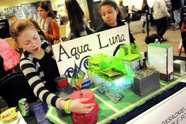 Kaliana Burnell, 12, left, and Jayda Griffin, 12, of Coxsackie-Athens Middle School with their team's futuristic city, Aqua Luna, during the National Engineers Week Future City Competition on Saturday, Jan. 10, 2015, at Proctors Theatre in Schenectady, N.Y. (Cindy Schultz / Times Union) Photo: Cindy Schultz / 00030088A