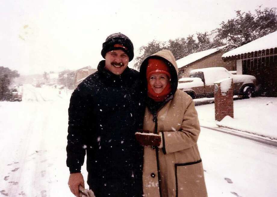 Steven Stoli and his mother, Mary Kay Fillingim, enjoy the record snowfall of Jan. 11-13, 1985, at Fillingim's home on the North Side. Stoli spent part of the weekend shuttling doctors and nurses to and from hospitals in his all-terrain vehicle. Fillingim threw snowballs and drank hot chocolate with family members. She later died in December 2010. Photo: Courtesy Photo / Courtesy Photo