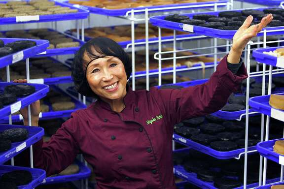 """Miyoko Schinner, founder of Miyoko's Kitchen, shows the cheese aging room. She published her first cookbook, """"The Now and Zen Epicure,"""" in 1991."""