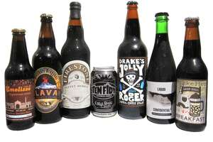 The Chronicle's stout picks for a warmer winter: Emelisse Espresso Stout (left), Ölvisholt Brugghús Lava Smoked Imperial Stout, Firestone Velvet Merkin Bourbon Barrel-Aged Oatmeal Stout 2014, Oskar Blues Ten Fidy Imperial Stout, Drake's Jolly Rodger Imperial Coffee Stout, To ØL Liquid Confidential Imperial Stout and Mikkeller Beer Geek Breakfast Oatmeal Stout.