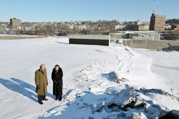Robert von Hasseln, left, director of Community and Economic Development for Amsterdam and Amsterdam Mayor Ann Thane pose at the construction site where the Mohawk Valley Gateway Overlook bridge will be built Thursday, Jan. 8, 2015, in Amsterdam, N.Y.  The city of Amsterdam is pictured in the background.  (Paul Buckowski / Times Union) Photo: Paul Buckowski / 00030103A