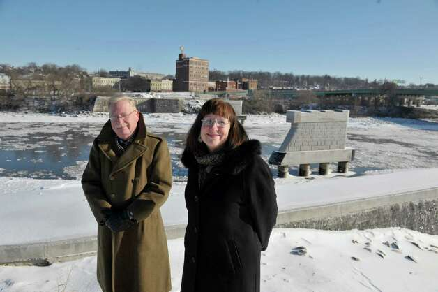 Robert von Hasseln, left, director of Community and Economic Development for Amsterdam and Amsterdam Mayor Ann Thane pose at the construction site where the Mohawk Valley Gateway Overlook bridge will be built Thursday, Jan. 8, 2015, in Amsterdam, N.Y.  The supports for the bridge are seen in the river in the background.  (Paul Buckowski / Times Union) Photo: Paul Buckowski / 00030103A