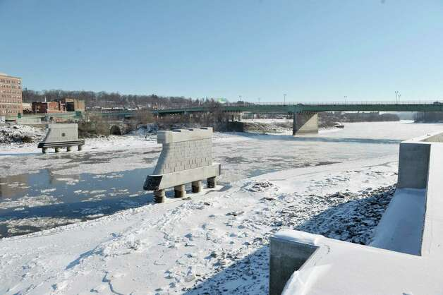 A view of the site where the Mohawk Valley Gateway Overlook bridge will be, on Thursday, Jan. 8, 2015, in Amsterdam, N.Y.  The supports for the bridge are seen in the river.  In the background is the Route 30 bridge which is how pedestrians get over the river currently.  (Paul Buckowski / Times Union) Photo: Paul Buckowski / 00030103A