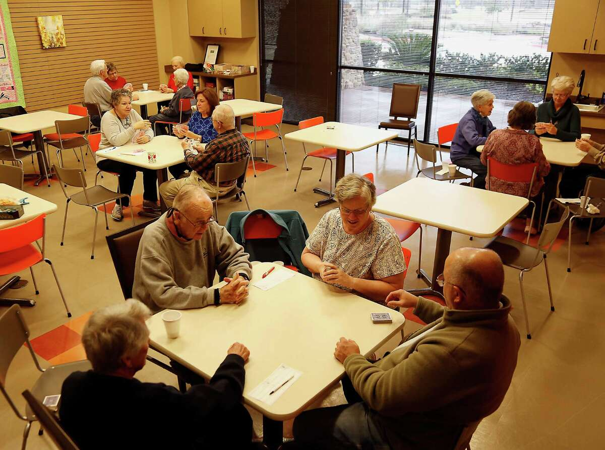 Residence playing cards at the Lake House amenities center at Del Webb Sweetgrass active adult community Friday, Jan. 9, 2015, in Richmond.( James Nielsen / Houston Chronicle )