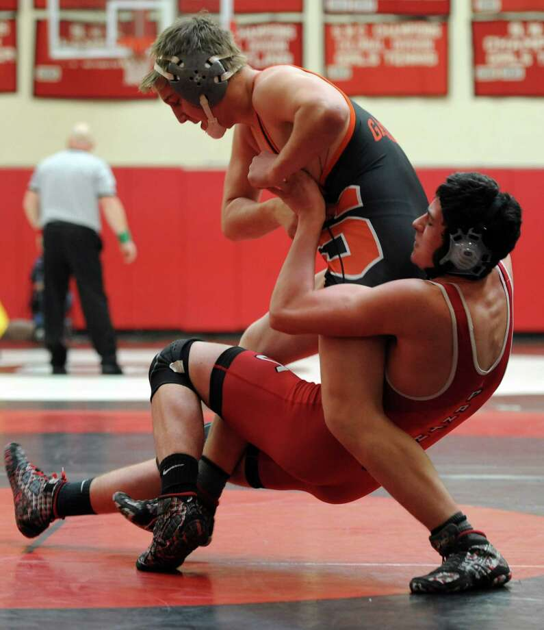 Shelton's Daniel Persson, left, and Masuk's Evan Patterson wrestle in the 160 lb. weight class Saturday, Jan. 10, 2015, during a tournament at Masuk High School in Monroe, Conn. Photo: Autumn Driscoll / Connecticut Post