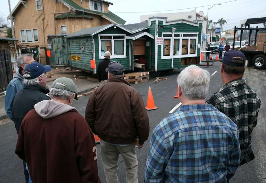 Regular customers watch a house moving crew relocate the historic Kingfish bar one block away to its new home on Telegraph Avenue in Oakland, Calif. on Saturday, Jan 10, 2015. Owners of the the old watering hole had to move the bar from its original location on Claremont Avenue to make way for condominiums. Photo: Paul Chinn, The Chronicle